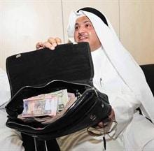 محمد الجويهل وشنطة الفلوس ربع مليون دينار