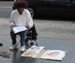 رسام مميز فعلا و يعرض صوره و رسوماته في شارع هوليوود
